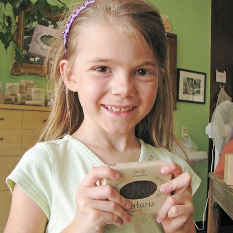 Erin McWilliams holding licorice soap bar